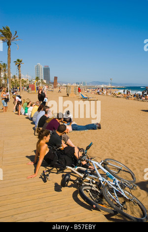 People relaxing at Platja de la Barceloneta beach in Barcelona Spain Europe - Stock Photo