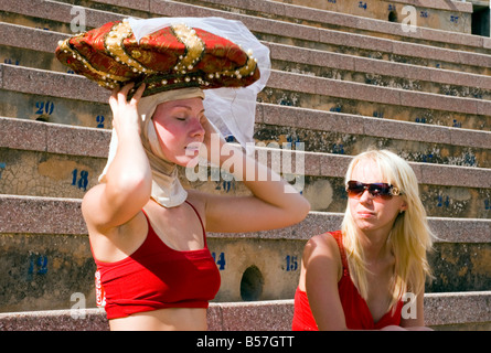 Member of the Ballet of the Theatre Usti nad Labem puts on a hat for a production of Carmina Burana Monumental Opera - Stock Photo