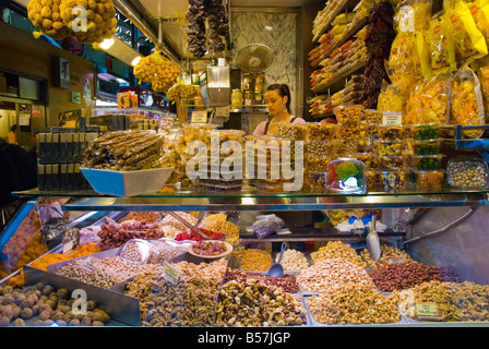 Stall selling nuts and seeds at La Boqueria market in Barcelona Spain Europe - Stock Photo