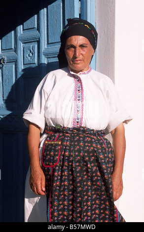greece, dodecanese islands, karpathos, avlona, greek woman wearing traditional clothes - Stock Photo
