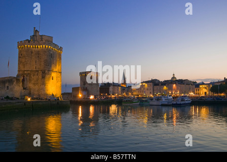 St. Nicholas and La Chaine towers at the entrance to the ancient port of La Rochelle, Charente-Maritime, France, - Stock Photo