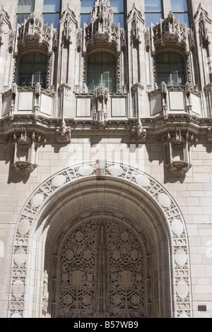 Ornate Gothic style entrance to the Tribune Tower, Chicago, Illinois, United States of America, North America - Stock Photo