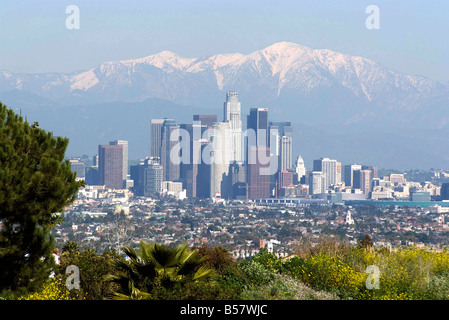 View of downtown Los Angeles looking towards San Bernardino Mountains, California, United States of America, North - Stock Photo