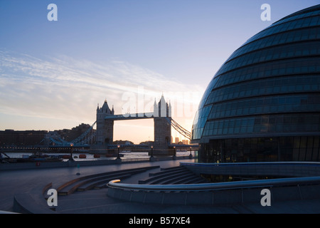 City Hall (London Assembly building) on Queens Walk, with Tower Bridge beyond, London, England, United Kingdom, - Stock Photo