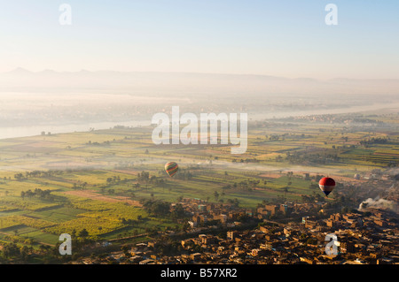 Hot air balloons over the West Bank (Western Thebes), Thebes, Egypt, North Africa, Africa - Stock Photo