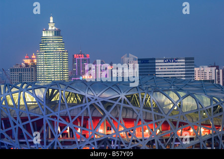 National Stadium in the Olympic Park illuminated at night, Beijing, China, Asia - Stock Photo