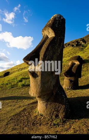 Giant monolithic stone Moai statues at Rano Raraku, Rapa Nui (Easter Island), UNESCO World Heritage Site, Chile, - Stock Photo