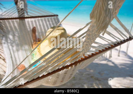 Woman relaxing in a hammock, Maldives, Indian Ocean, Asia - Stock Photo