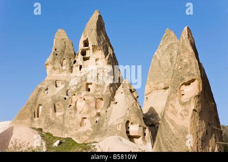 Old troglodytic cave dwellings in Uchisar, Cappadocia, Anatolia, Turkey, Asia Minor, Eurasia - Stock Photo