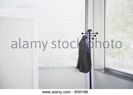 ... Suit Jacket Hanging On Office Coat Rack   Stock Photo