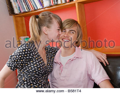 Teenage couple flirting in cafe - Stock Photo