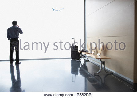Businessman waiting in airport - Stock Photo