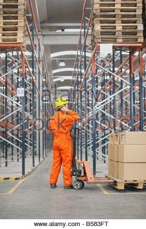 Man working in warehouse - Stock Photo
