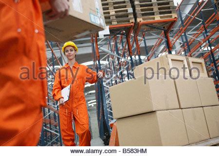 Woman working in warehouse - Stock Photo