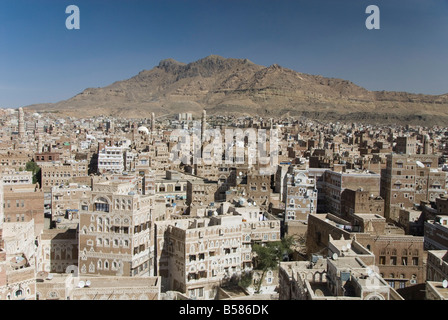 View across Old City of traditional tall brick-built houses, Sana'a, UNESCO World Heritage Site, Yemen, Middle East - Stock Photo
