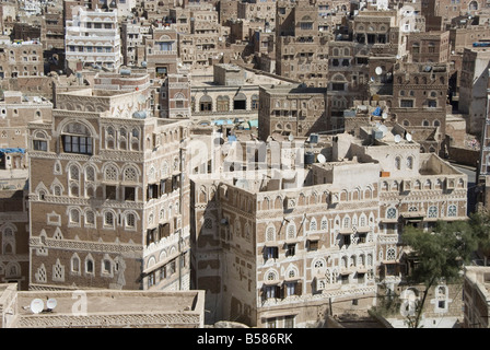 Traditional ornamented brick architecture on tall houses in Old City, Sana'a, UNESCO World Heritage Site, Yemen, - Stock Photo