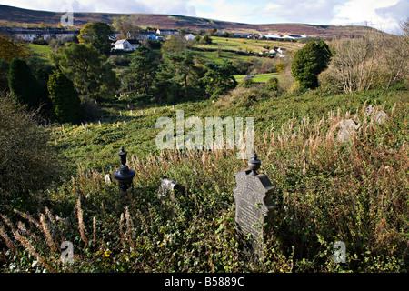 Headstones in overgrown graveyard Blaenavon Wales UK - Stock Photo