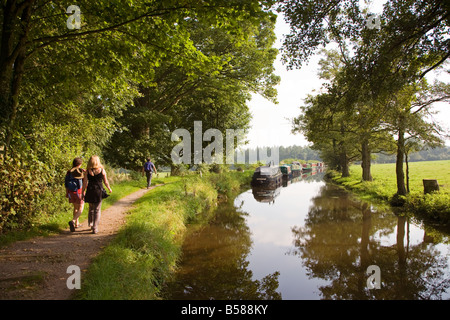 People walking on canal towpath Brecon and Monmouthshire canal Wales UK - Stock Photo