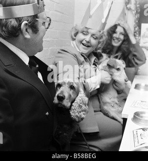 Dog Owners and their pets seen here having a Christmas party. December 1976 76-07481-002 - Stock Photo
