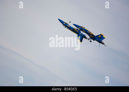 The elite US Navy Blue Angels speed in formation at hundreds of miles per hour above Andrews Air Force Base, Maryland, - Stock Photo