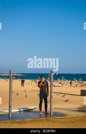 Man having a shower at Platja de la Barceloneta beach in Barcelona Spain Europe - Stock Photo