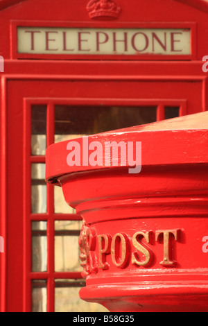 British red letter box next to a public telephone box, Warwick, UK - Stock Photo