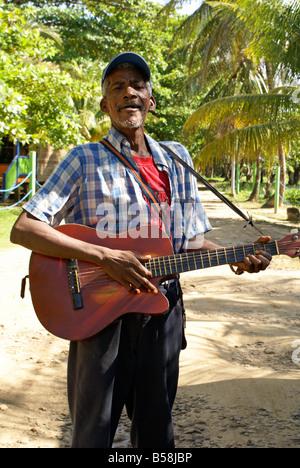 Black Nicaraguan man playing the guitar and singing on Big Corn Island, Nicaragua, Central America - Stock Photo