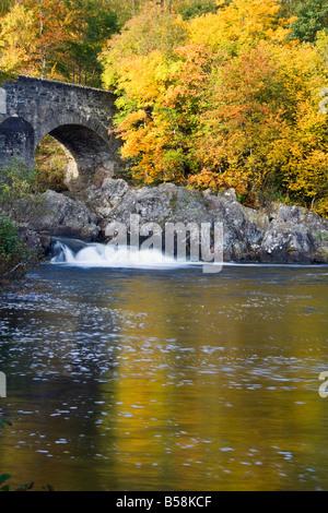 Autumn colour at the Bridge of Balgie Glen Lyon Scotland - Stock Photo