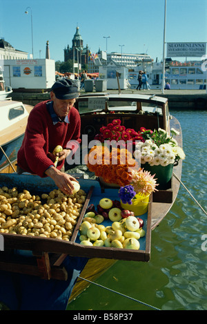 Flowers, potatoes and onions for sale on the waterfront of the harbour in Helsinki, Finland, Scandinavia, Europe - Stock Photo