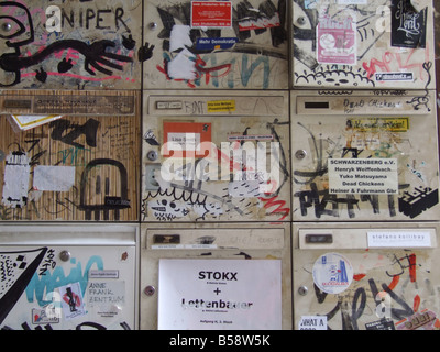 mail boxes covered with graffiti in berlin germany - Stock Photo