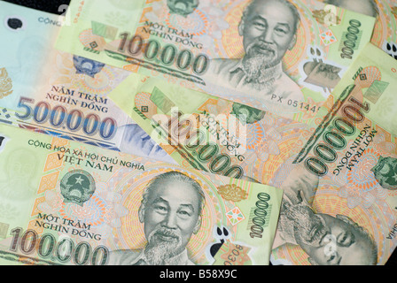 Currency of Vietnam issued by the State Bank of Vietnam dong Portrait of Ho Chi Minh on the bank note VND money - Stock Photo