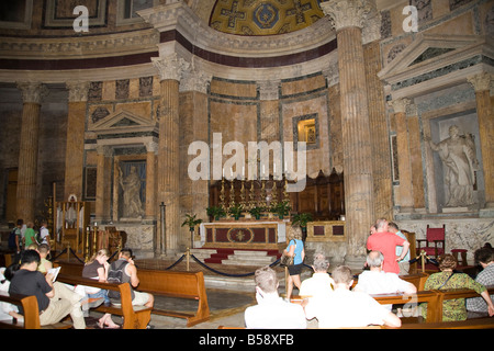The altar and tourists inside the Pantheon, Piazza della Rotonda, Rome, Italy - Stock Photo