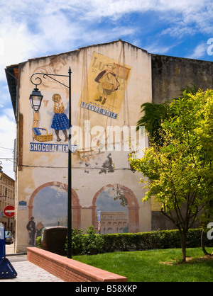 Vintage French advertising posters painted as a street art mural in Moissac Tarn et Garonne France Europe - Stock Photo