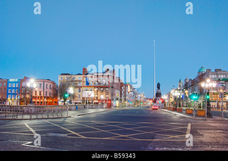 Dawn in Dublin looking north over OConnell Bridge towards the spire - Stock Photo
