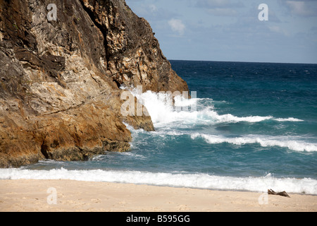 South Gorge with sandy beach and sea waves crashing on cliffs on North Stradbroke Island Queensland QLD Australia - Stock Photo