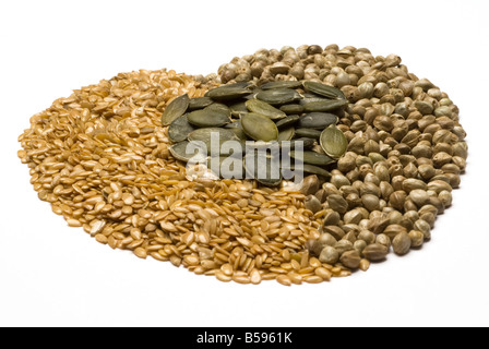 Heart shape made from linseed, hemp and pumpkin seeds, all a rich source of Omega-3 - Stock Photo