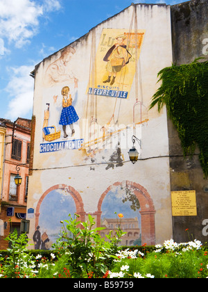 Vintage French advertising posters painted as a street art mural in Moissac, Tarn et Garonne, France, Europe - Stock Photo
