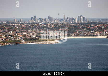 Aerial view north west of Honeycombe Bay South Coogee city scyscrapers in distance Sydney NSW Australia High level - Stock Photo