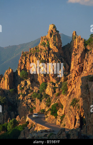 The Calanche white granite rocks with car on road below near Piana Corsica France R Tomlinson - Stock Photo