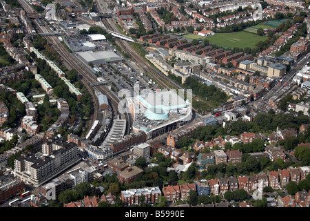 Aerial view north west of Finchley Road Frognal Rail and Tube Stations shops suburban houses Hampstead Cricket Club - Stock Photo
