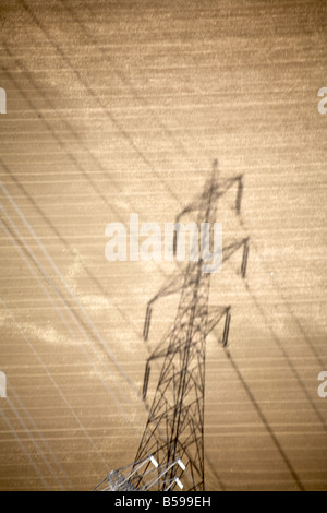 Abstract aerial view north east of electricity pylon silhouette in country field Cambridgeshire England UK High - Stock Photo