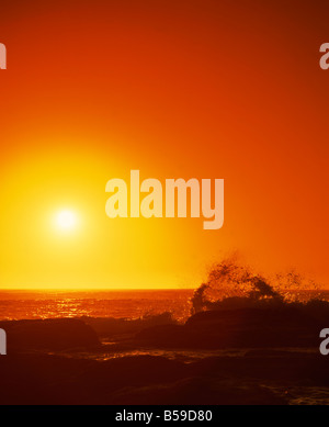 Sunset over the Indian Ocean with waves breaking on coastline of Prevwlly Western Australia Australia Pacific - Stock Photo
