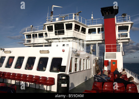 Red Funnel car and vehicle ferry deck on Southampton Water in evening light England UK - Stock Photo