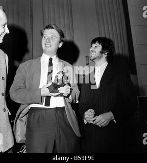 Geoffrey Emerick, an engineer at EMI gets an award from Ringo Starr March 1968 Y02309-001 - Stock Photo