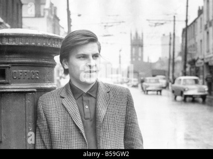 Alan Price posing in Percy Street Newcastle - Stock Photo