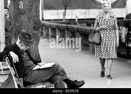 An elderly gent reading his newspaper on a park bench in Luxembourg City . April 1975 75-2201-011 - Stock Photo