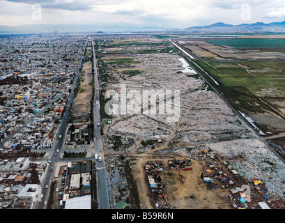 aerial view above Mexico City garbage dump in Nezahualoyotl in former Lake Texcoco basin - Stock Photo