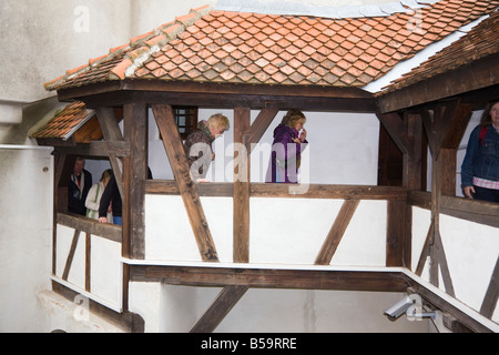 Bran Transylvania Romania Europe Dracula s Castle tourists on balcony around inner courtyard - Stock Photo