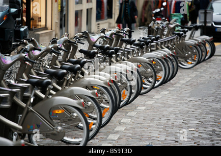 Bicycles for hire in the middle of Paris, France - Stock Photo