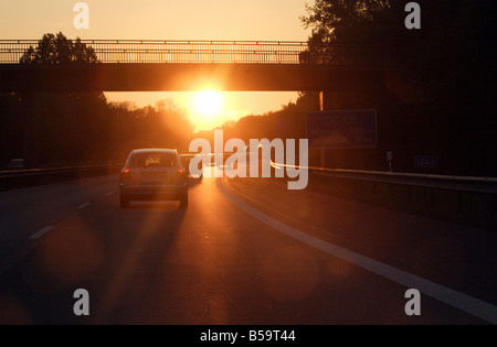 Sunset on the highway A30, Roedinghausen, Germany - Stock Photo